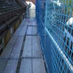 Gerüstbau mit Dachfang in München